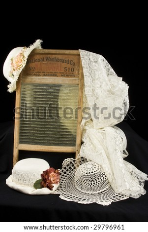 Antique items including old fashioned hats hanging on old washboard - stock photo