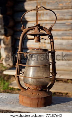 Antique kerosene lamp on the background wall of a village house