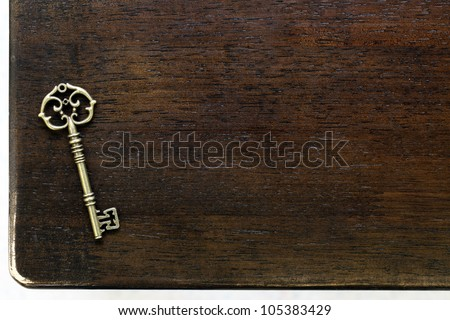 Antique key on wooden table