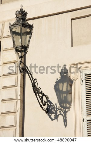 stock-photo-antique-lamp-on-side-of-royal-palace-in-turin-italy-48890047.jpg