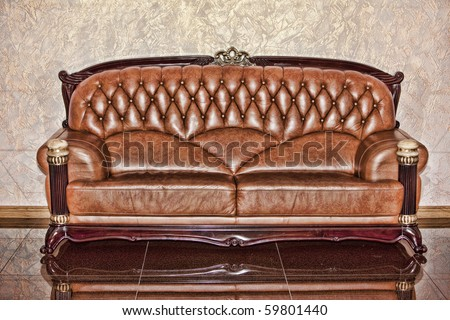 Antique leather brown sofa in the room