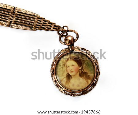 Antique locket with portrait of little girl - stock photo