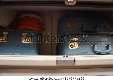 Antique Luggage in an Airplane's Overhead Bin                     #1396995266