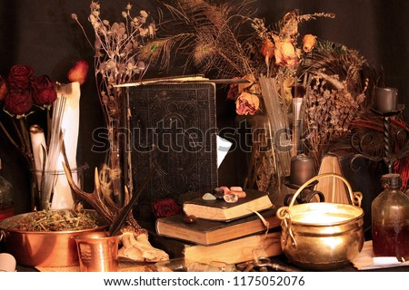 Antique Magic Book. Witchcraft Peacock feathers and candle background. Black candle Magic Ritual #1175052076