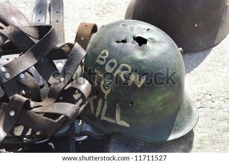 "ANTIQUE MARKET. Flea market in Munich, Germany. Soldier's helmet with an inscription ""Born to kill"""