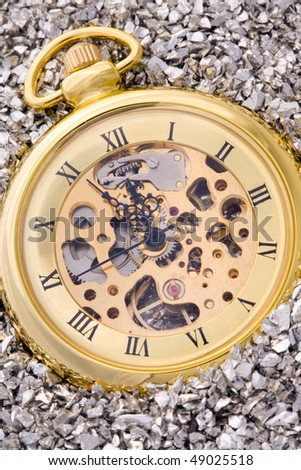 Antique mechanical pocket watch on silver nuggets.