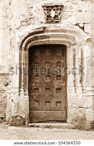 Antique medieval door in the old city of Le Mans, France