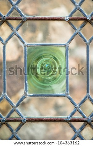 Antique medieval glass door in the old city of Le Mans, France