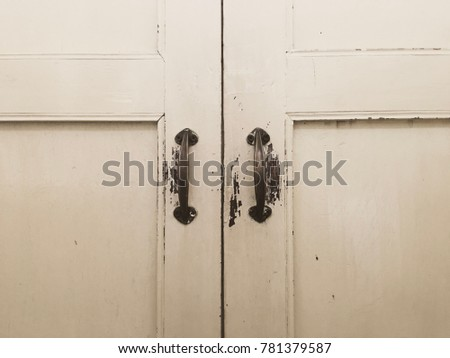 Antique Metal Door Handles On The Old Wooden Door Interior Window