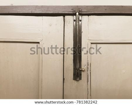 Antique Metal Door Latch On The Old Wooden Door. Interior Window And Door  Decoration.