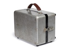 Antique metal portable case isolated on white
