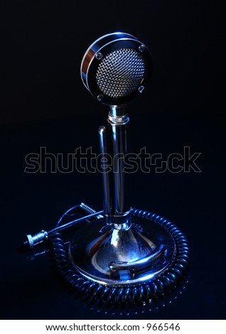 Antique microphone on black background