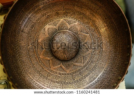 Antique Middle East hand craft bowl with Arabic / Turkish / Persian typography. made from metal Cooper. golden color bowl used as fortune tellers tool. islamic culture. iran turkey arabs culture. #1160241481