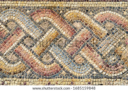 Antique mosaic ornament in the Archaeological Park of Paphos. Cyprus. Foto stock ©