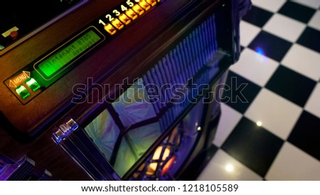 Antique music playing device in retro style cafe, vintage jukebox, old fashion #1218105589