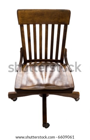 Antique oak swivel chair isolated on white. - stock photo