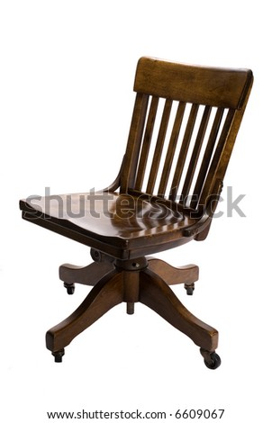 Antique oak swivel chair isolated on white.