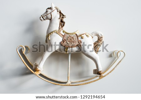 Antique old toy white rocking horse isolated on white. Copy space Photo stock ©