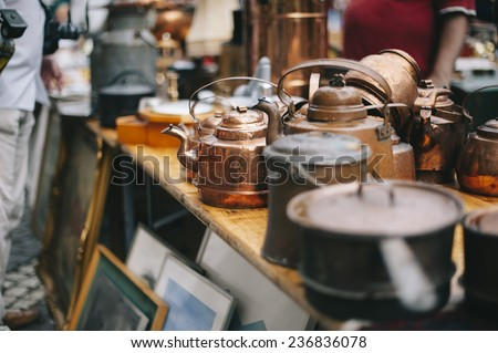 antique pans and pots at the street market in sweden - Shutterstock ID 236836078