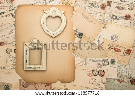 antique picture frames, old letters and handwritten postcards. nostalgic vintage background