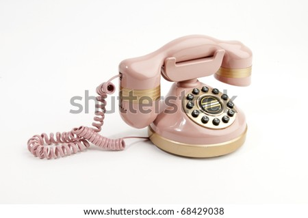 Antique pink phone isolated on white