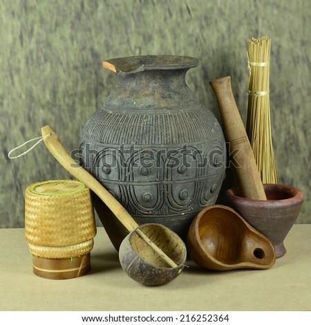 Antique pitcher and ancient kitchen utensils.