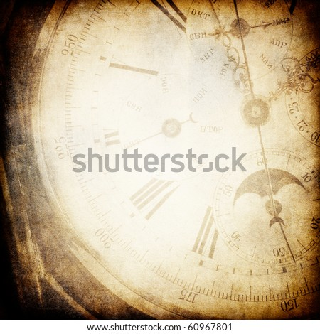 Antique pocket clock face. Grunge background with copyspace.