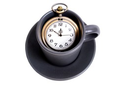 Antique pocket watch in a coffee cup isolated on white. Coffee time concept.