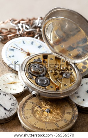 Antique pocket watches with visible jewels inside