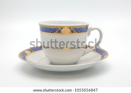 antique porcelain blue tea cup on saucer with gold edging isolated on white background #1055056847
