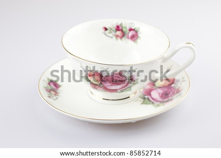 Antique porcelain China tea cup on white background