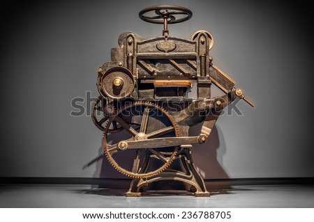antique printing press over...
