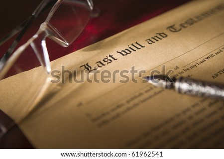 Antique quill and Old-fashioned paper with text of Last will