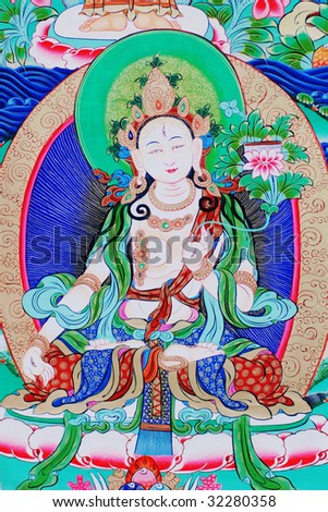 """antique """"Thangka"""" : is a painted or embroidered Buddhist banner which was hung in a monastery or a family altar and carried by lamas in ceremonial processions. - stock photo"""