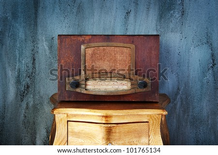 antique radio in a antique drawer on a abstract background - stock photo