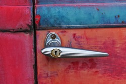 Antique Red Ford Door Handle Weathered and Rusted