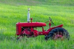 Antique red tractor in field, Palouse agricultural region of Eastern Washington State.