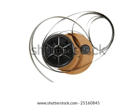 Antique reels of movie film against white background