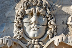 Antique relief representing head of Medusa, in the ruins of the Temple of Apollo in Didyma, Aydin, Turkey