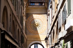Antique renaissance clock with sun (a star) on the back of the mechanical, astronomical Clock in the Torre dell'Orologio (Clock Tower) in Piazza della Loggia, Brescia, Lombardy, Italy. Architecture.