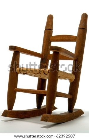 Antique reproduction of miniature scale model toy wood rocking chair over white