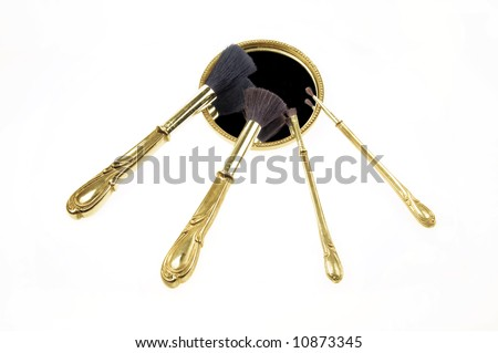 Antique retro makeup brush set and small pocket mirror isolated on white background