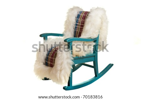 Antique rocking chair with woven sheep skin isolated on white - stock photo