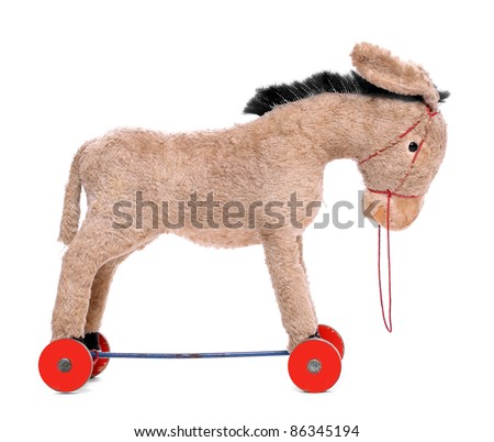 Antique rocking donkey, wooden toy isolated on a white. Traditional christmas gift. Product is 80 years old.