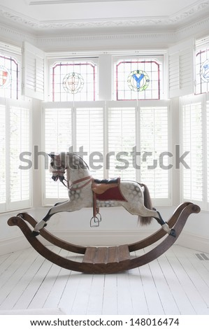 Antique rocking horse in bay window with stained glass Photo stock ©