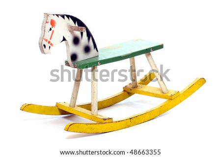 Antique rocking horse wooden toy isolated on white.