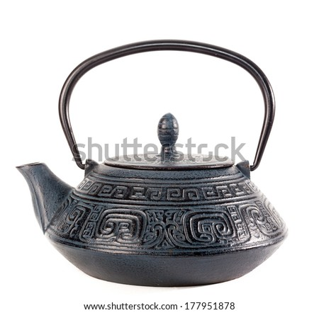 antique ron tea pot with oriental pattern on white background
