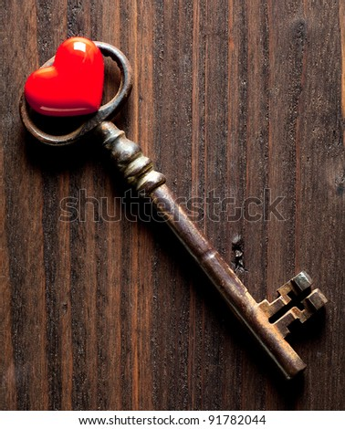 Antique rusty key and a red heart for Valentine's day