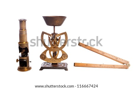 Antique scales, scale, microscope, isolated on white.