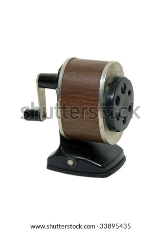 Antique school pencil sharpener with a manual turn crank - path included